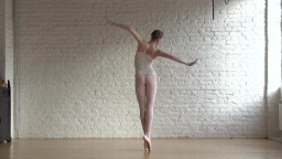 Tiny and flexible ballerina Annett stretching naked